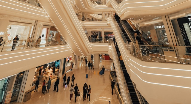 shopping mall with people and escalators