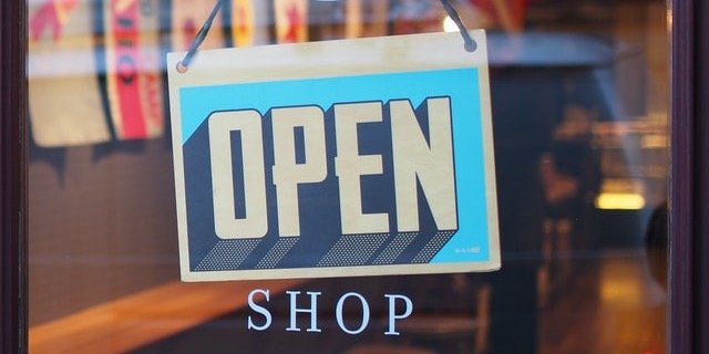 """""""open"""" sign at a retail store"""